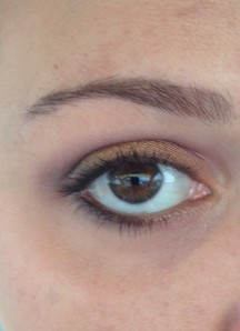 Gold on the eyelid, pink in the crease, dark brown on the outer V and lower lashline